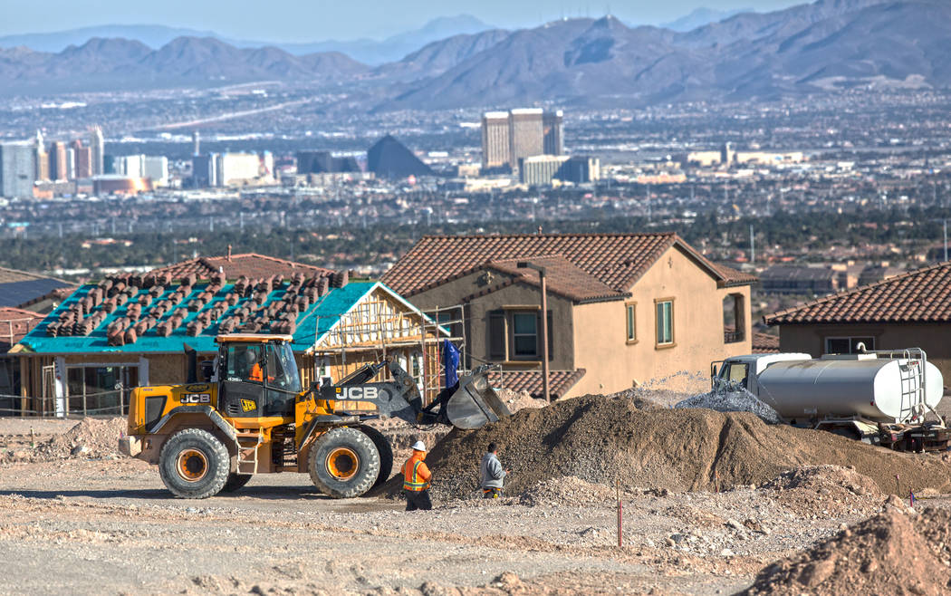 Construction workers prep the area south of The Paseos in Summerlin for new home construction on Feb. 28, 2017. (Benjamin Hager RJNewHomes.Vegas)