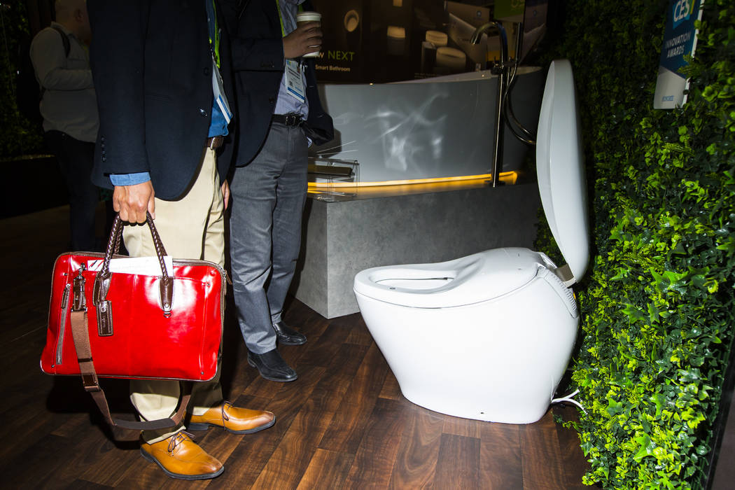Attendees look at a luxury smart toilet by Toto at the Sands Expo and Convention Center during CES in Las Vegas on Wednesday, Jan. 9, 2019. Chase Stevens Las Vegas Review-Journal @csstevensphoto
