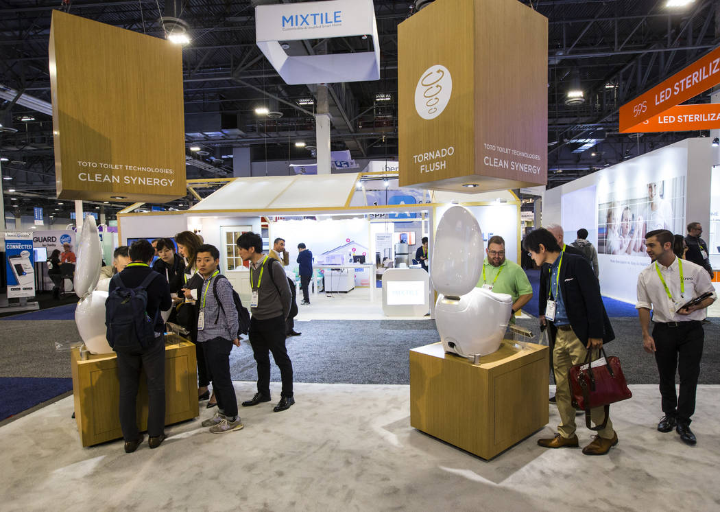 Attendees look at the Neorest NX2 smart toilet by Toto at the Sands Expo and Convention Center during CES in Las Vegas on Wednesday, Jan. 9, 2019. Chase Stevens Las Vegas Review-Journal @csstevens ...