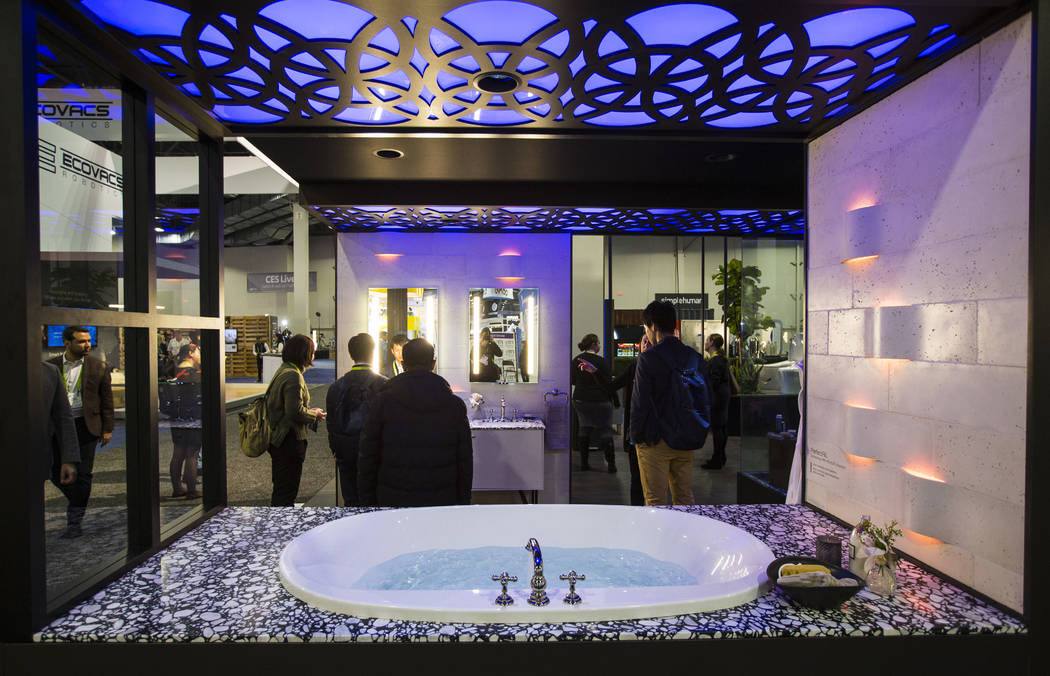 Attendees look at smart bathroom products by Kohler at the Sands Expo and Convention Center during CES in Las Vegas on Wednesday, Jan. 9, 2019. Chase Stevens Las Vegas Review-Journal @csstevensphoto
