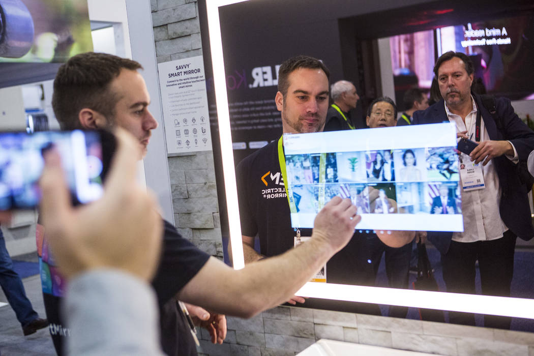 Robert Zerr talks about Electric Mirror products at the Sands Expo and Convention Center during CES in Las Vegas on Wednesday, Jan. 9, 2019. Chase Stevens Las Vegas Review-Journal @csstevensphoto