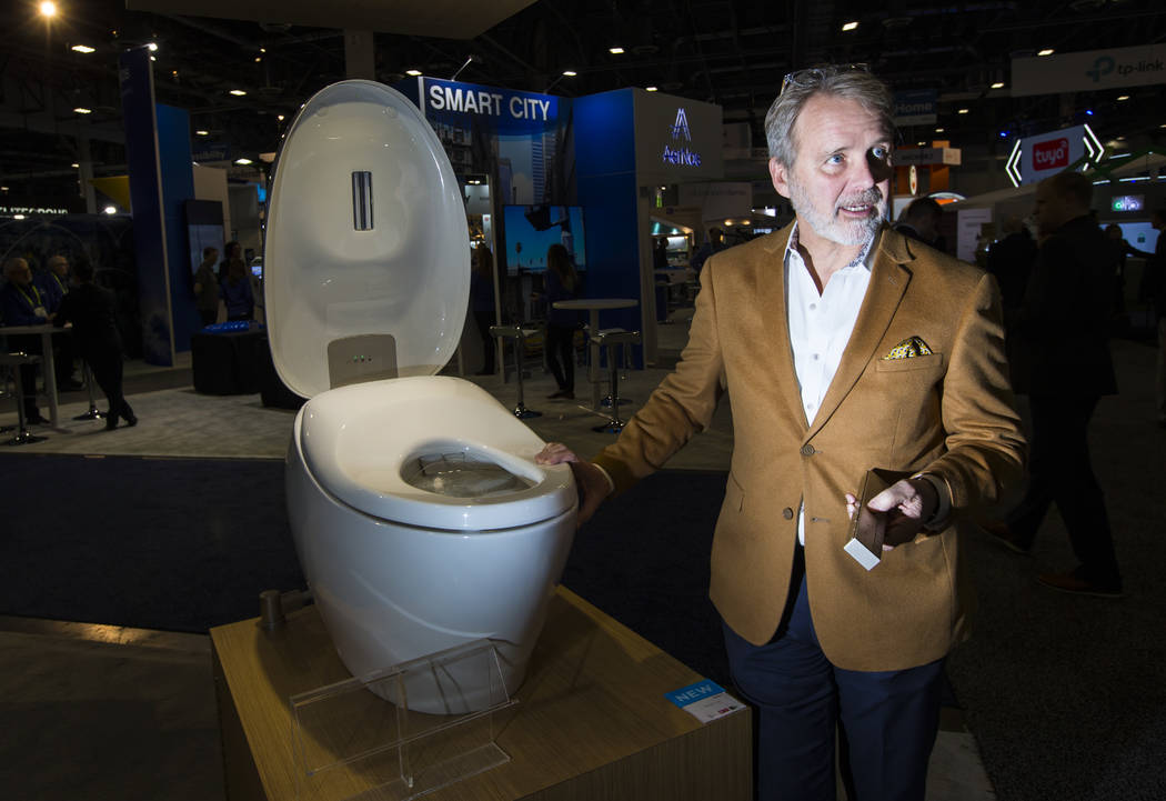 Bill Strang, president of operations and ecommerce at Toto, talks about the Neorest NX2 smart toilet at the Sands Expo and Convention Center during CES in Las Vegas on Wednesday, Jan. 9, 2019. Cha ...