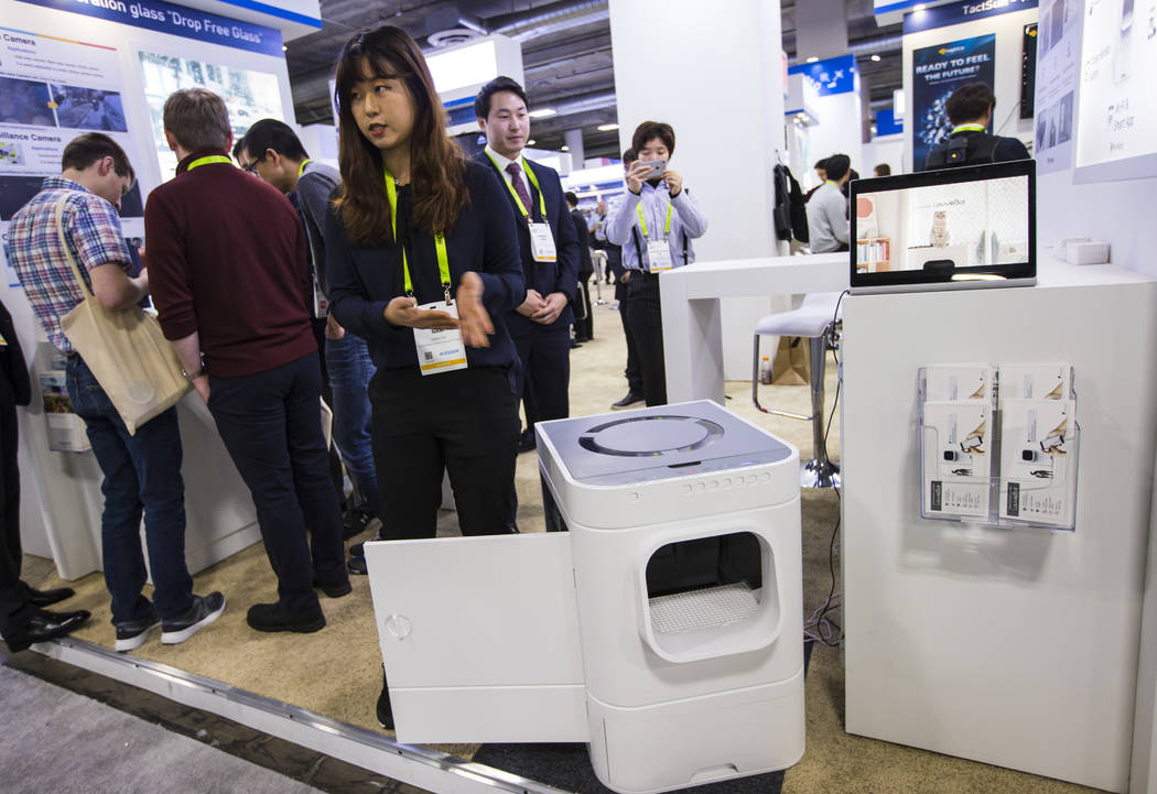 Heaven Nam talks about the LavvieBot automated litter box by PurrSong at the Sands Expo and Convention Center during CES in Las Vegas on Wednesday, Jan. 9, 2019. Chase Stevens Las Vegas Review-Jou ...