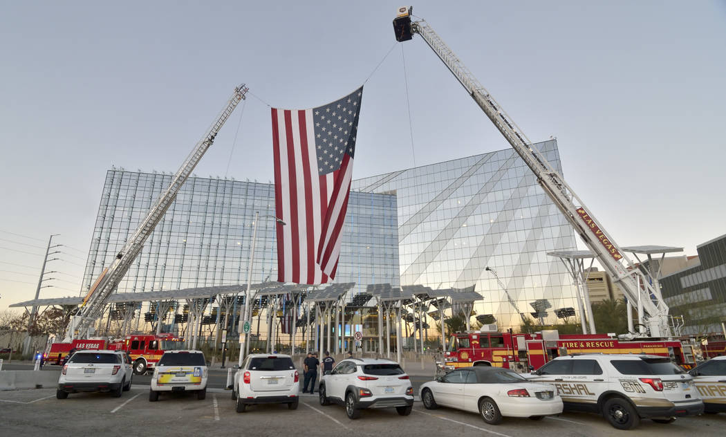 A flag flies between two Las Vegas Fire and Rescue trucks outside of City Hall before Las Vegas Mayor Carolyn Goodman delivers her State of the City address on Thursday, Jan. 10, 2019. Bill Hughes ...