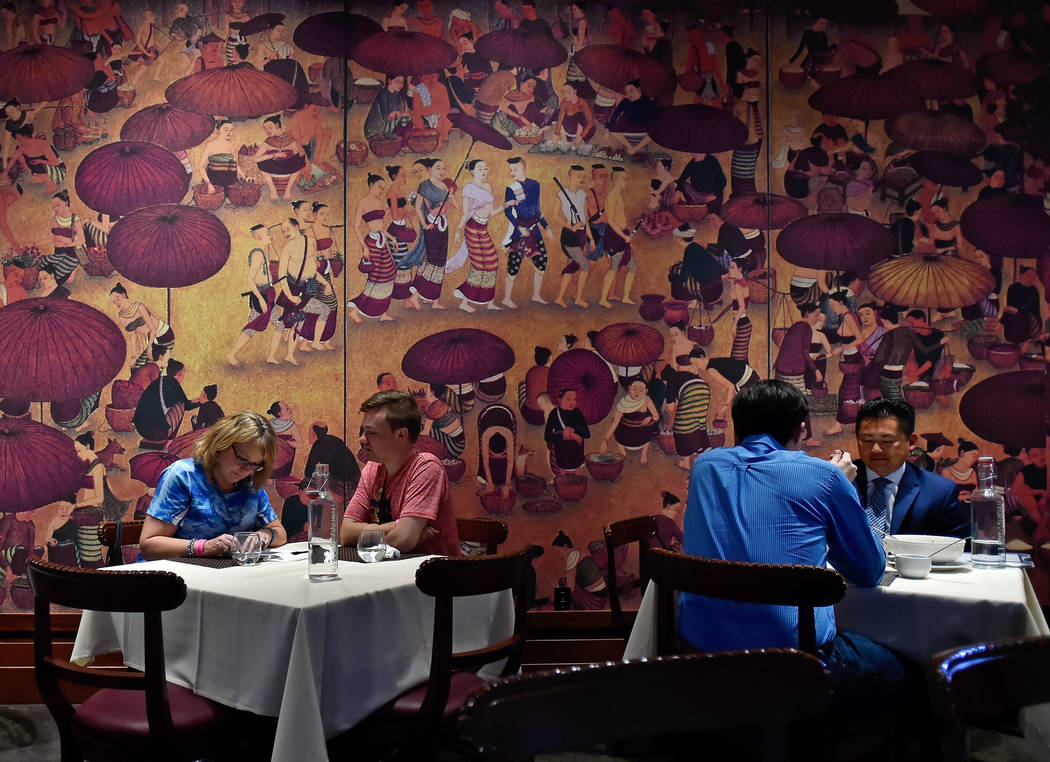 Diners sit in front of one of the many murals that decorate the dinning room at Lotus of Siam restaurant Friday, May 11, 2018, in Las Vegas. (David Becker/Las Vegas Review-Journal) @davidjaybecker