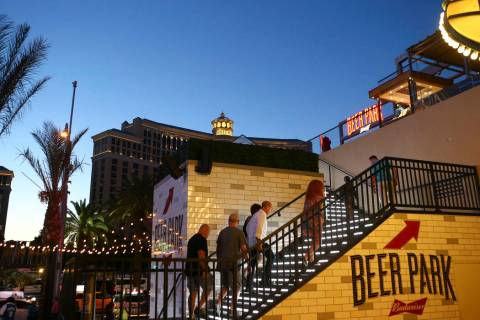 People make their way to Beer Park at the Paris hotel-casino in Las Vegas on Friday, Nov. 4, 20 ...