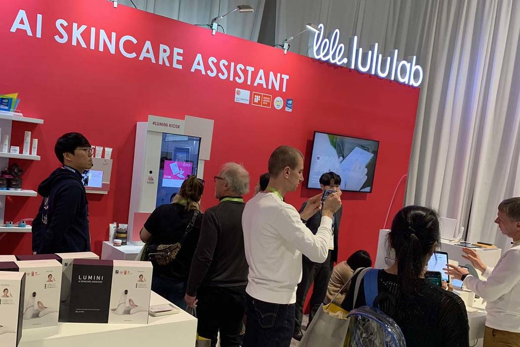 People listen to product representatives talk about Lumini by Lululabs, billed as an AI skincare assistant, on the convention floor at CES 2019 on Thursday, Jan. 10, 2019. (Mat Luschek/Las Vegas R ...