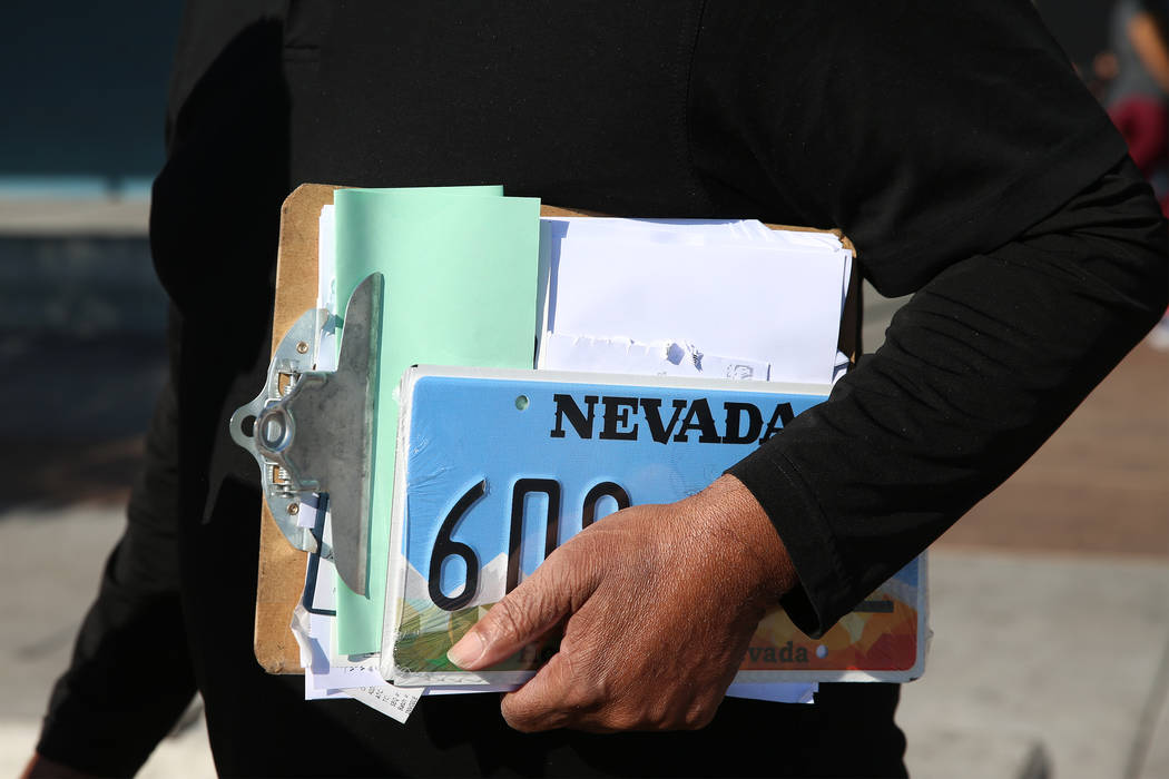 Cylee Dinkins III holds a new set of license plates as he interviewed about his visit to the Nevada Department of Motor Vehicles on East Sahara Avenue in Las Vegas, on Thursday, Jan. 10, 2019. Eri ...