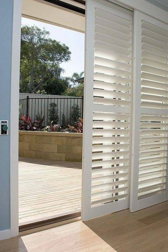 Sliding Wood Shutter Panels Are The Most Por Option For Covering A Gl Door