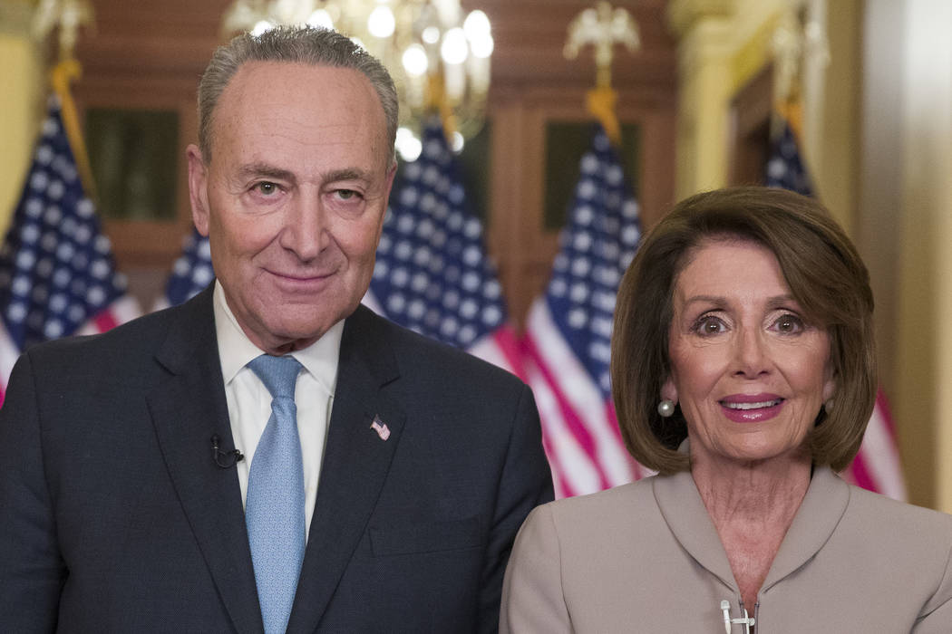 Senate Minority Leader Chuck Schumer of N.Y., and House Speaker Nancy Pelosi of Calif., pose for photographers after speaking on Capitol Hill in response President Donald Trump's address, Tuesday, ...