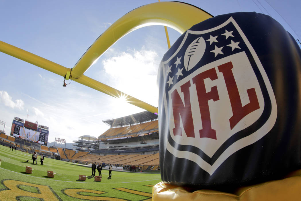 The NFL Logo is on a pad on the goal post at Heinz Field before an NFL football game between the Pittsburgh Steelers and the Cincinnati Bengals, Sunday, Dec. 30, 2018, in Pittsburgh. (AP Photo/Gen ...