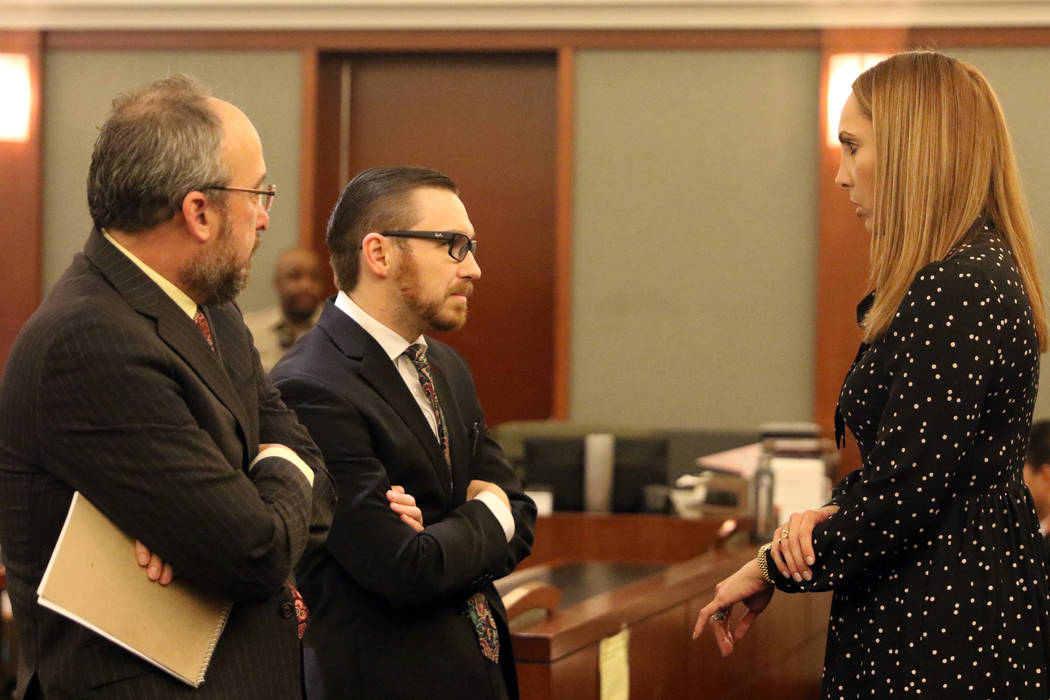 Attorney Alexis Plunkett, right, who prosecutors say bragged about putting a hit on her former boyfriend in prison, speaks to her lawyers, Michael Becker, left, and Adam Solinger prior to her cour ...