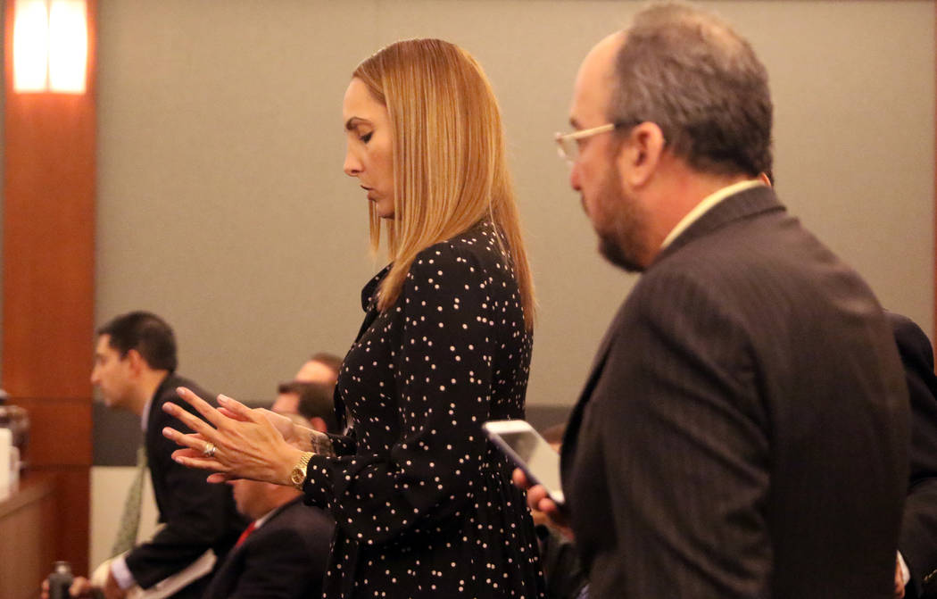 Attorney Alexis Plunkett, left, who prosecutors say bragged about putting a hit on her former boyfriend in prison, stands by her lawyer, Michael Becker prior to her court hearing at the Regional J ...