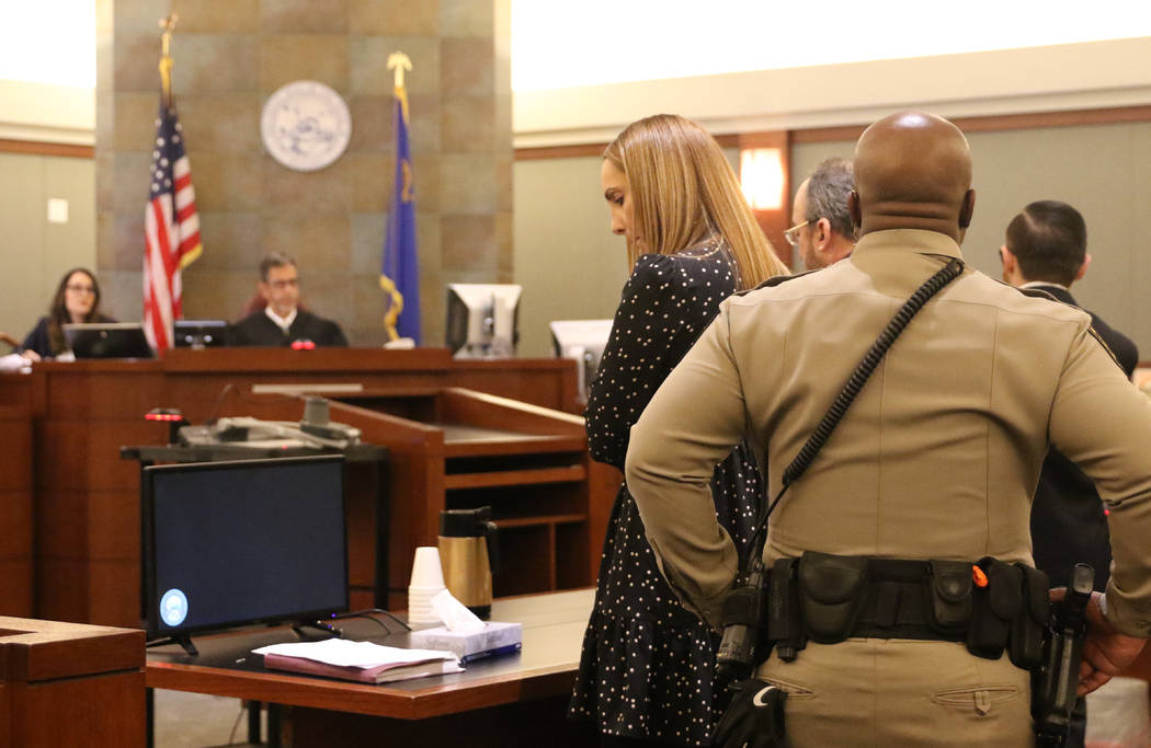 Attorney Alexis Plunkett, who prosecutors say bragged about putting a hit on her former boyfriend in prison, glances at a notepad during her court hearing at the Regional Justice Court in Las Vega ...