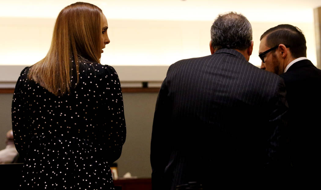 Attorney Alexis Plunkett, left, who prosecutors say bragged about putting a hit on her former boyfriend in prison, converses with her lawyers, Michael Becker, center, and Adam Solinger during her ...