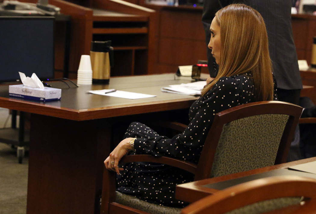Attorney Alexis Plunkett, who prosecutors say bragged about putting a hit on her former boyfriend in prison, sits in the defendant chair during her court hearing, Thursday, Jan. 10, 2019, at the R ...