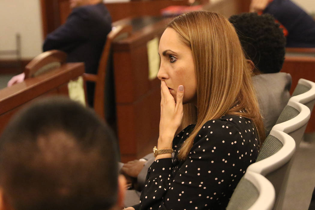Attorney Alexis Plunkett, who prosecutors say bragged about putting a hit on her former boyfriend in prison, waits to be called for her court hearing on Thursday, Jan. 10, 2019, at the Regional Ju ...