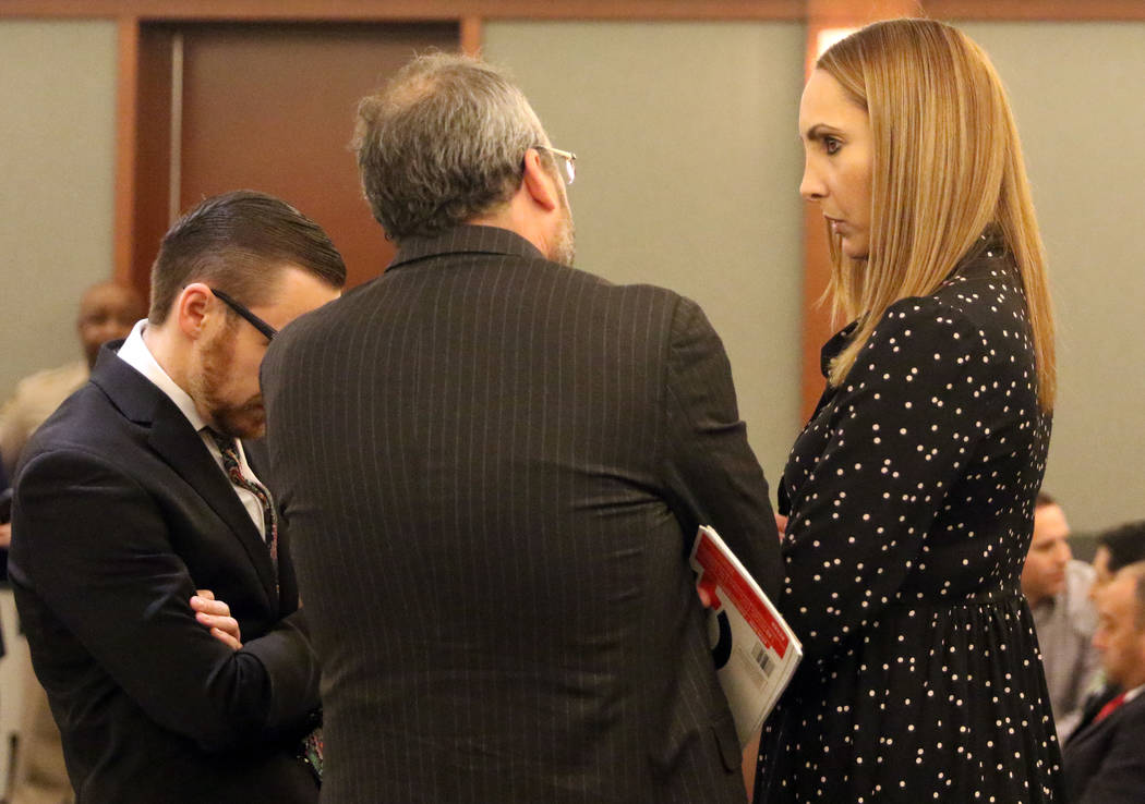 Attorney Alexis Plunkett, right, who prosecutors say bragged about putting a hit on her former boyfriend in prison, converses with her lawyers, Michael Becker, center, and Adam Solinger prior to h ...