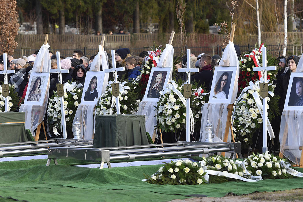 Pictures of five girls who died in an entertainment escape room fire last week, during their joint burial at a cemetery in Koszalin, northern Poland, on Thursday, Jan. 10, 2019. They died from car ...