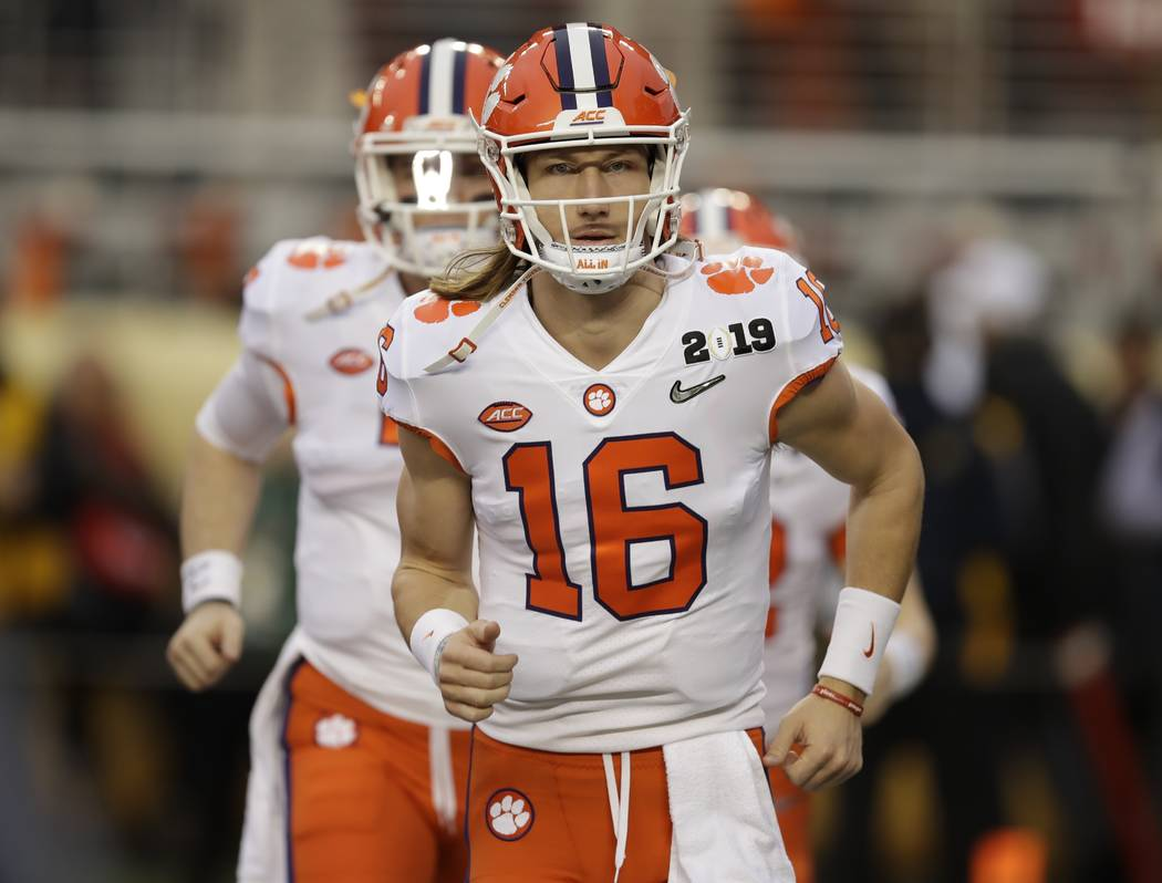 Clemson's Trevor Lawrence warms up before the NCAA college football playoff championship game against Alabama Monday, Jan. 7, 2019, in Santa Clara, Calif. (AP Photo/Ben Margot)