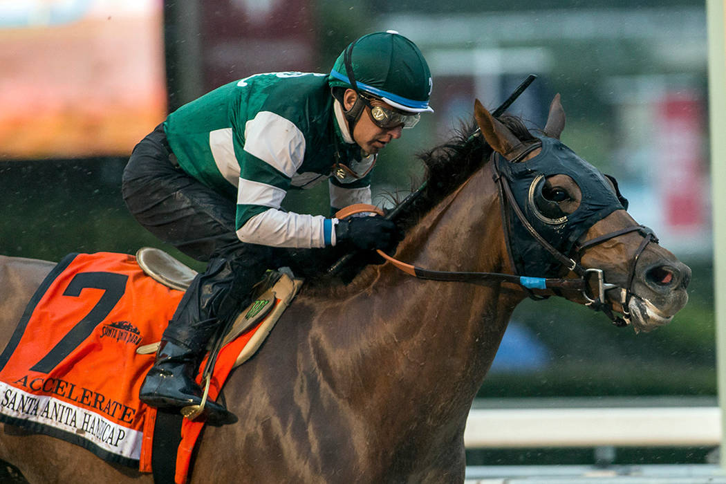 Accelerate, with Victor Espinoza aboard, wins the Santa Anita Handicap horse race at Santa Anita Park in Arcadia, Calif., on March 10, 2018. Accelerate leads the 14-horse field for the Breeders' C ...