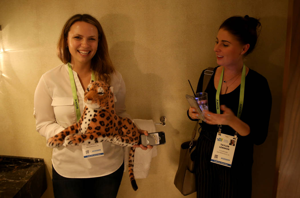 Sierra Dasso, left, and Taylor Lemmon of San Francisco pose with a tiger plush toy during the Hardware Massive CES 2019 Happy Hour Bash at The Hangover Suite at Caesars Palace in Las Vegas Wednes ...