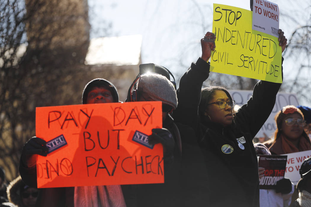 Union members and other federal employees rally to call for an end to the partial government shutdown, Thursday, Jan. 10, 2019 at AFL-CIO Headquarters in Washington. (AP Photo/Pablo Martinez Mons ...