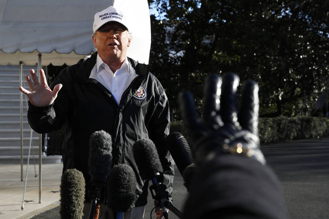 President Donald Trump gestures as a reporter raises her hand to ask a question, as he speaks to the media on the South Lawn of the White House, Thursday Jan. 10, 2019, in Washington, en route for ...