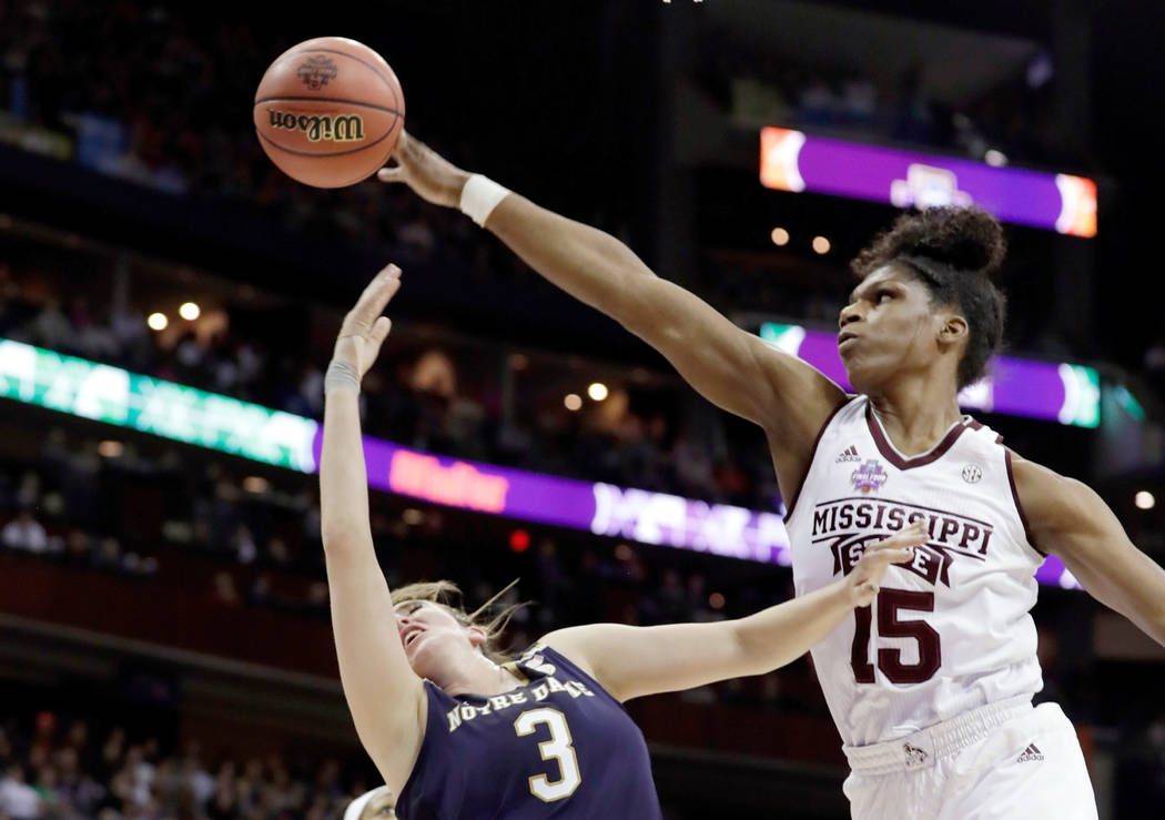 In this April 1, 2018, file photo, Mississippi State's Teaira McCowan (15) blocks a shot by Notre Dame's Marina Mabrey (3) during the first half in the final of the women's NCAA Final Four college ...
