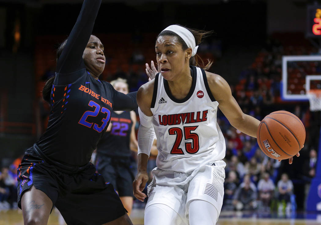 In this Monday, Nov. 19, 2018 file photo, Louisville guard Asia Durr (25) drives towards the basket while under pressure from Boise State guard Jayde Christopher (23) in the first half of an NCAA ...