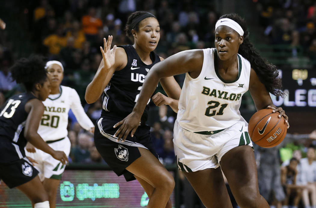In this Thursday, Jan. 3, 2019 file photo, Baylor center Kalani Brown (21) works around Connecticut forward Napheesa Collier during the second half of an NCAA college basketball game in Waco, Texa ...
