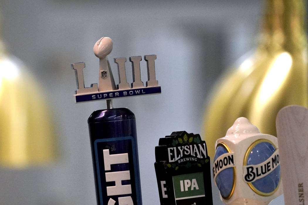 A Super Bowl LIII logo beer tap is shown during a tour of Mercedes-Benz Stadium for the NFL Super Bowl 53 football game Tuesday, Jan. 29, 2019, in Atlanta. (AP Photo/David J. Phillip)