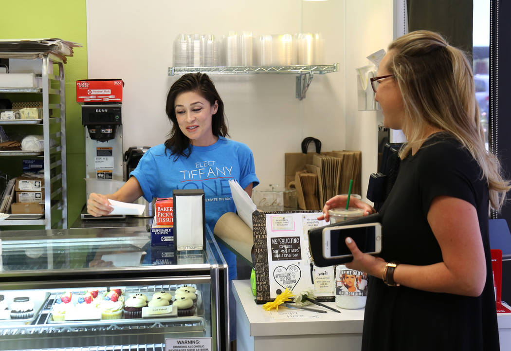 Tiffany Jones, left, owner of Peridot Sweets in Las Vegas, takes an order for a wedding cake from Courtney Rolfsness on Monday, Sept. 17, 2018. Jones, a Republican, is one of nearly 50 women runni ...