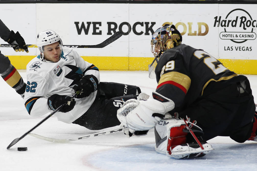 San Jose Sharks right wing Kevin Labanc (62) falls while trying to shoot on Vegas Golden Knights goaltender Marc-Andre Fleury (29) during the third period of an NHL hockey game Saturday, Nov. 24, ...