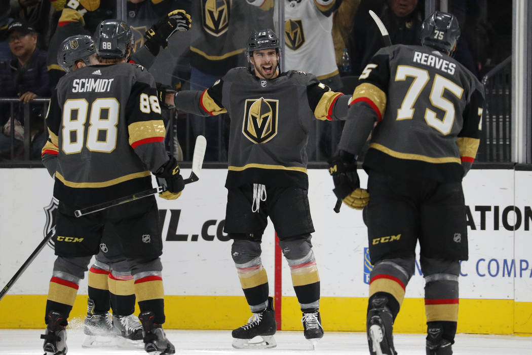 Vegas Golden Knights center Brandon Pirri, center, celebrates after scoring against the Los Angeles Kings during the third period of an NHL hockey game Tuesday, Jan. 1, 2019, in Las Vegas. (AP Pho ...