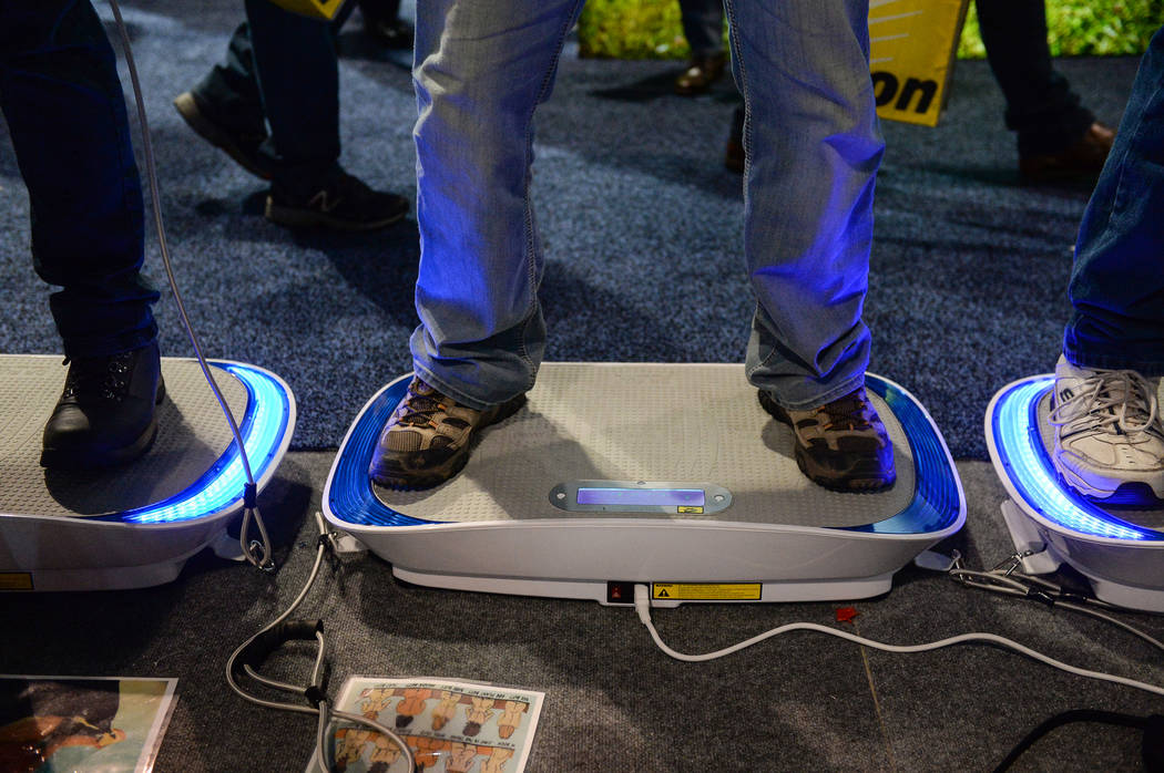 Attendees try out Dr. Fuji's Cyber Body Slimmer at the Las Vegas Convention Center during the third day of CES in Las Vegas, Thursday, Jan. 10, 2019. Caroline Brehman/Las Vegas Review-Journal