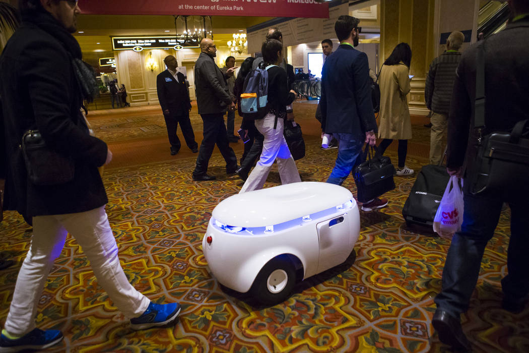 Augustin Desfosses, left, of robotics company Sterela, controls a mobile robotic platform at the Sands Expo and Convention Center during CES in Las Vegas on Thursday, Jan. 10, 2019. Chase Stevens ...