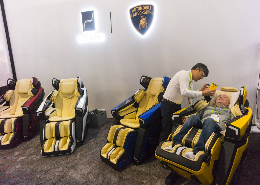 Daniel Jang of Bodyfriend talks to Review-Journal reporter Chris Lawrence about the $30,000 massage chair modeled after the Lamborghini Aventador at the Sands Expo and Convention Center during CES ...