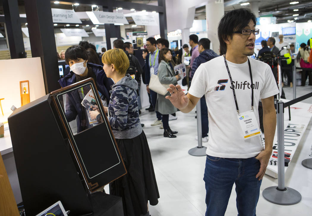 Takuma Iwasa talks about Drinkshift, a smart beer refigerator, at the Sands Expo and Convention Center during CES in Las Vegas on Thursday, Jan. 10, 2019. Chase Stevens Las Vegas Review-Journal @c ...
