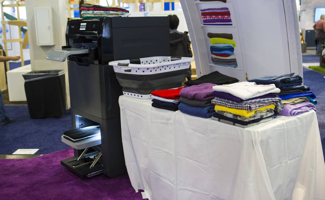 Laundry-folding robot Foldimate, left, on display at the Sands Expo and Convention Center during CES in Las Vegas on Thursday, Jan. 10, 2019. Chase Stevens Las Vegas Review-Journal @csstevensphoto