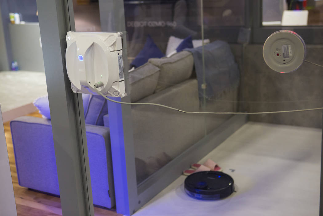 The Ecovacs Winbot cleans a window at the Sands Expo and Convention Center during CES in Las Vegas on Thursday, Jan. 10, 2019. Chase Stevens Las Vegas Review-Journal @csstevensphoto