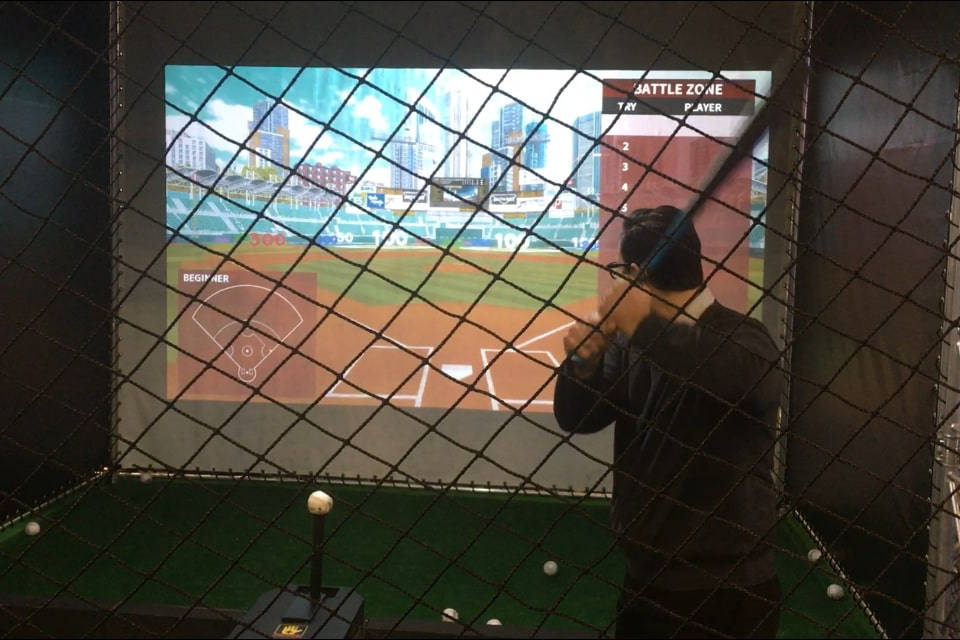 A man prepares to swing while using the Autobat baseball simulator at CES. By Ben Gotz, Las Vegas Review-Journal.