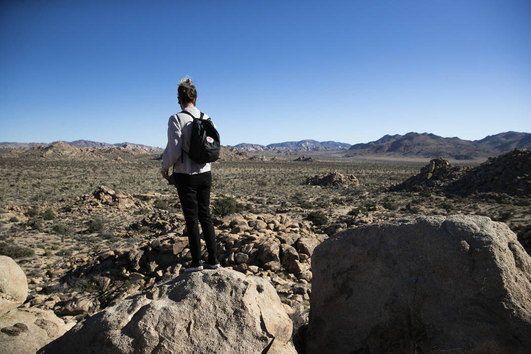 Trae Elliott visits Joshua Tree National Park in Southern California's Mojave Desert, Thursday, Jan. 10, 2019. The national park won't be closing because of the partial government shutdown after a ...