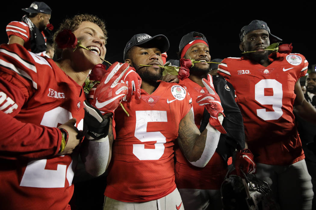 Ohio State players celebrate after a 28-23 win over Washington in the Rose Bowl NCAA college football game Tuesday, Jan. 1, 2019, in Pasadena, Calif.(AP Photo/Jae C. Hong)