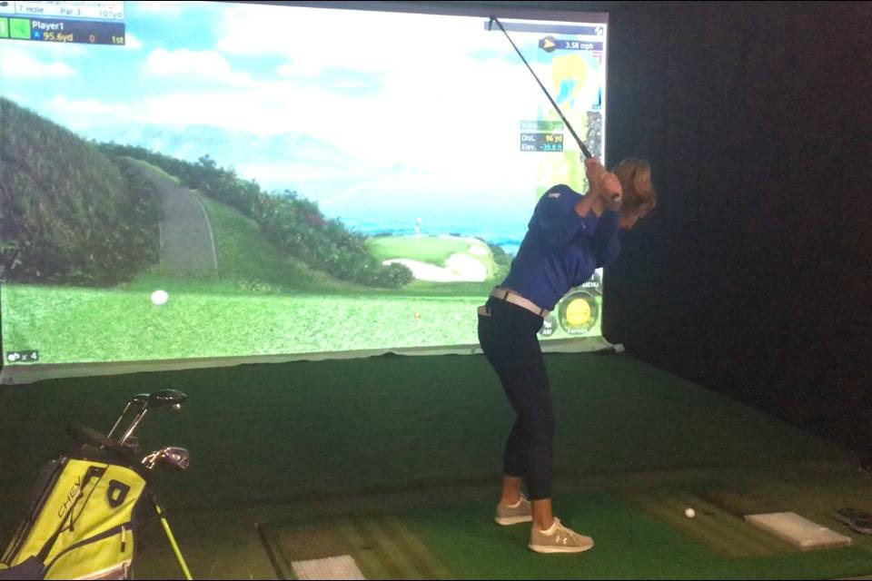 LPGA Tour player Alison Lee prepares to swing while testing the GOLFZON golf simulator Thursday at CES. (Ben Gotz/Las Vegas-Review Journal)