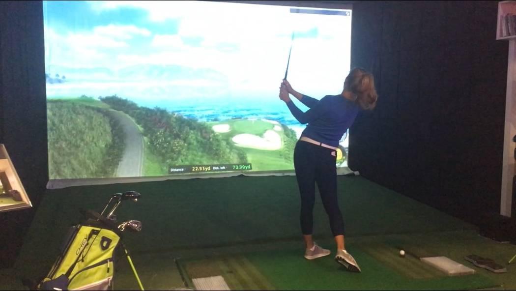 LPGA Tour player Alison Lee swings while testing the GOLFZON golf simulator Thursday at CES. (Ben Gotz/Las Vegas-Review Journal)