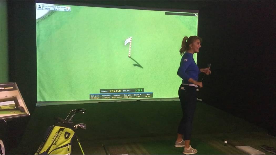 LPGA tour player Alison Lee smiles while testing the GOLFZON golf simulator Thursday at CES. (Ben Gotz/Las Vegas-Review Journal)