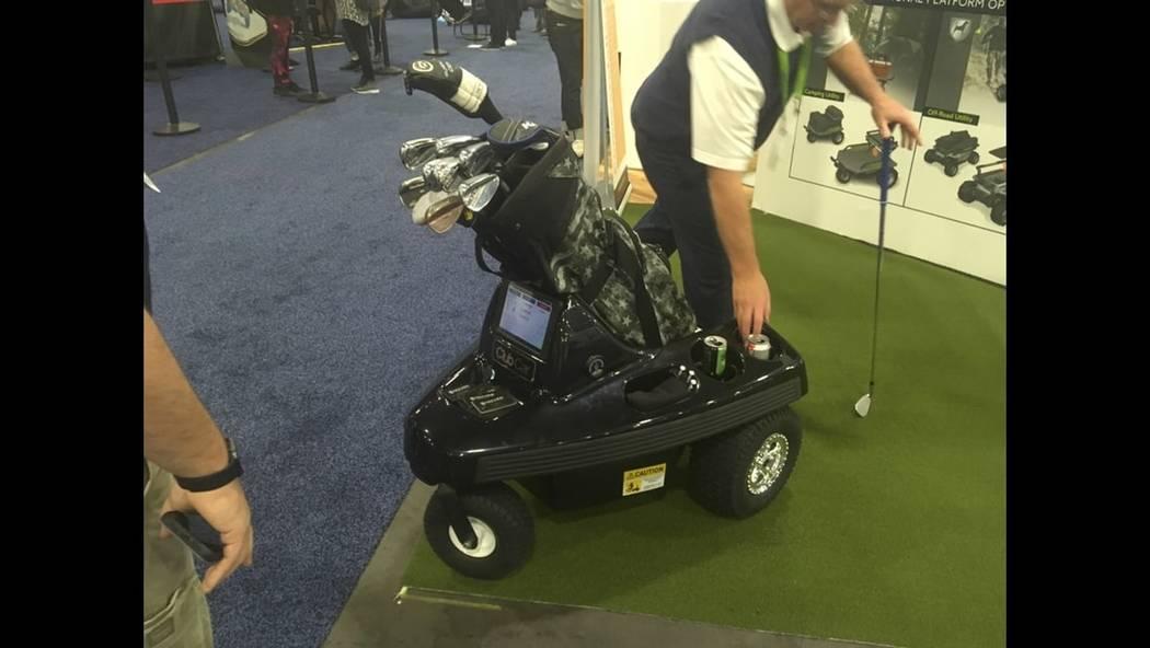 Inventor Tim Doane shows off the Rover robotic golf caddy Thursday at CES. (Ben Gotz/Las Vegas Review-Journal)