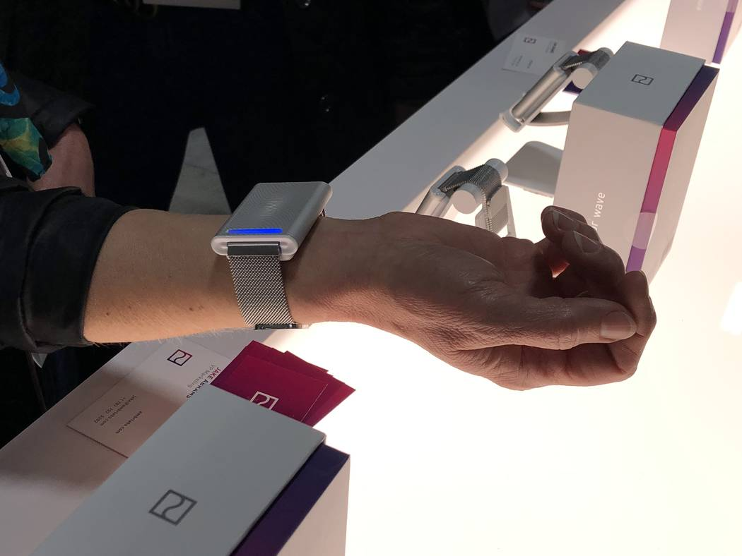 A CES 2019 attendee with an Embr Wave bracelet. The device makes the wearer feel five degrees warmer or cooler and sells in the U.S. and Canada for $299. (Bailey Schulz/Las Vegas Review-Journal)