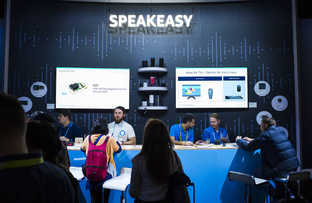 Attendees are assisted in a room showcasing products integrated with Amazon's Alexa at the Sands Expo and Convention Center during CES in Las Vegas on Thursday, Jan. 10, 2019. Chase Stevens Las Ve ...